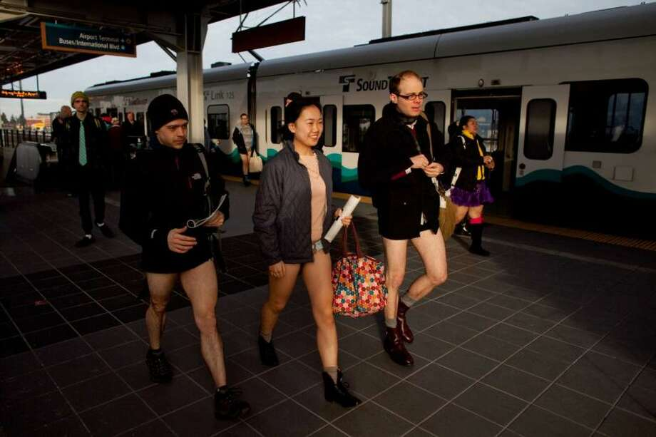 People exit the train during Emerald City Improv's No Pants Light Rail Ride on Sunday, January 13, 2013. Dozens of participants took off their pants while riding on the train, shocking some other passengers. Photo: JOSHUA TRUJILLO/SEATTLEPI.COM