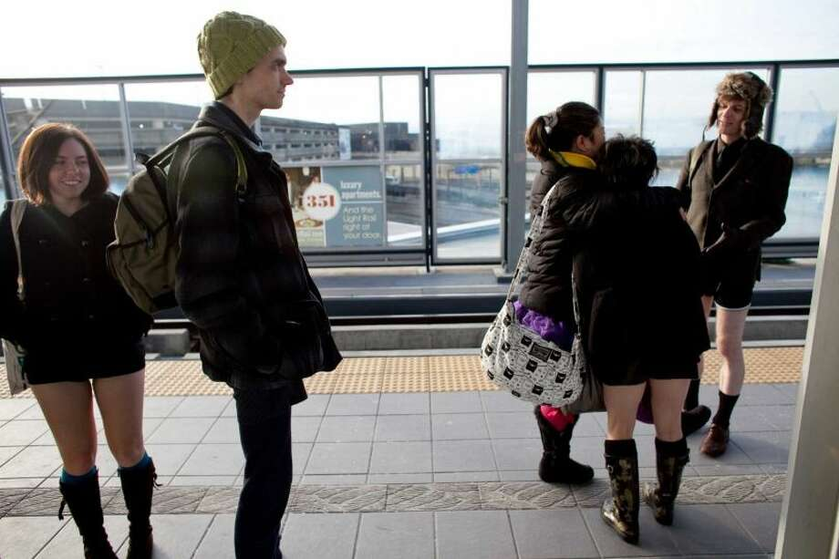 People gather at the Sea-Tac station during Emerald City Improv's No Pants Light Rail Ride on Sunday, January 13, 2013. Dozens of participants took off their pants while riding on the train, shocking some other passengers. Photo: JOSHUA TRUJILLO/SEATTLEPI.COM