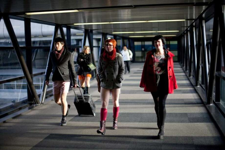 Participants walk into Sea-Tac Airport during Emerald City Improv's No Pants Light Rail Ride on Sunday, January 13, 2013. Dozens of participants took off their pants while riding on the train, shocking some other passengers. Photo: JOSHUA TRUJILLO/SEATTLEPI.COM