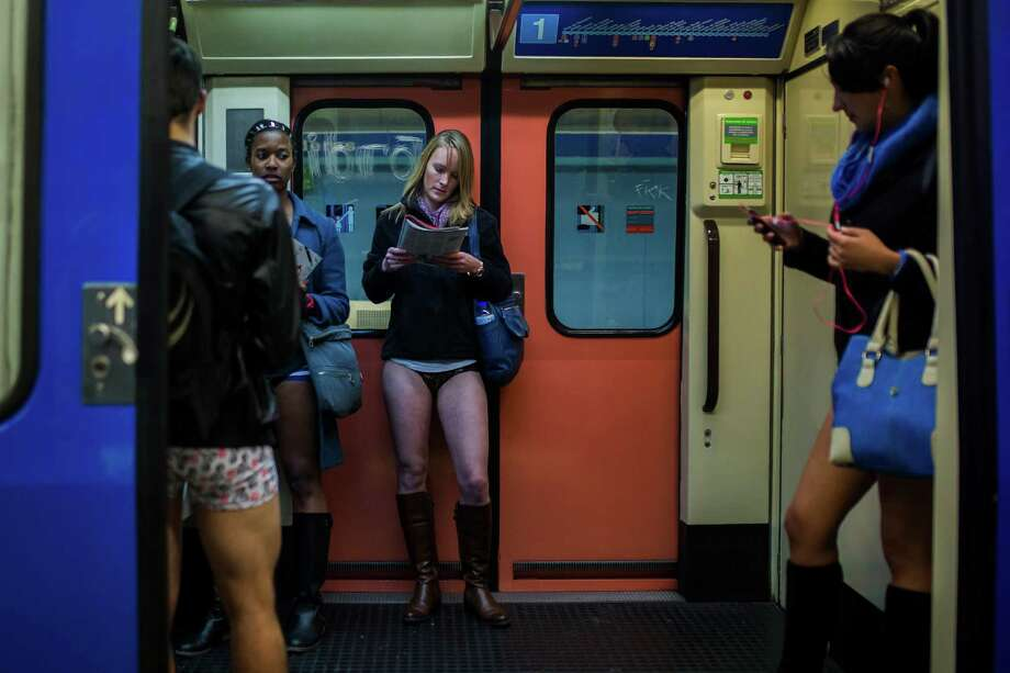 "Participants travel on the train without their pants during the 5th annual ""No Pants Subway Ride"" in Madrid, Spain, Sunday, Jan. 12, 2014. Photo: Andres Kudacki, AP / AP"