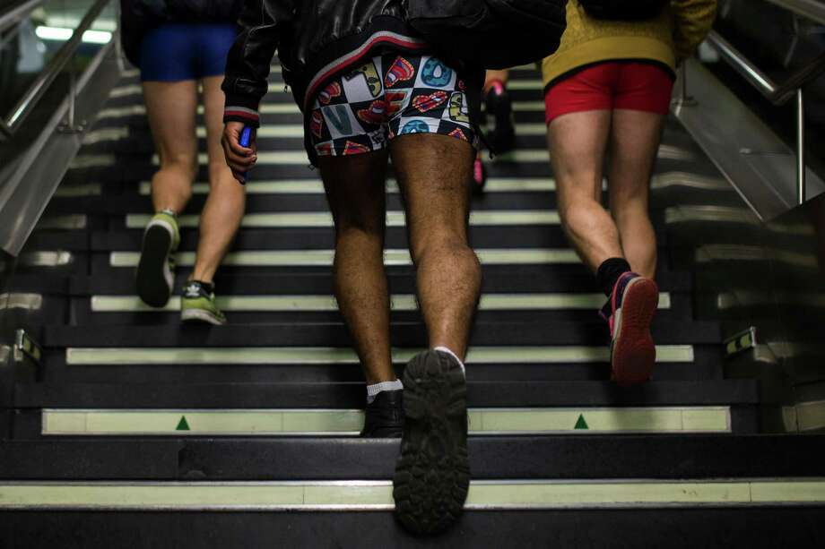 "Participant walk up the stairs with no pants on during the 5th annual ""No Pants Subway Ride"" in Madrid, Spain, Sunday, Jan. 12, 2014. Photo: Andres Kudacki, AP  / AP"