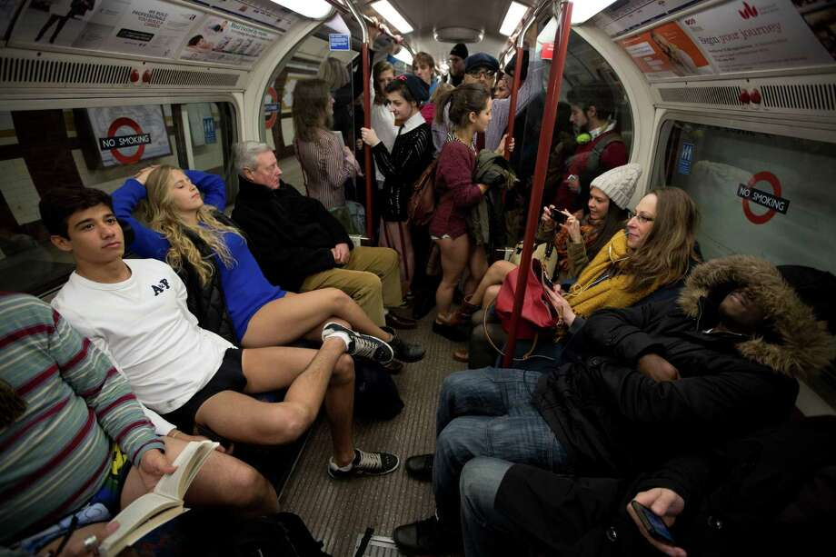 "People take part in the ""No Trousers Tube Ride"" event next to other passengers on an underground train in London, Sunday, Jan. 12, 2014.  The stunt was held to coincide with the ""Global No Pants Subway Ride"", where passengers board subway cars in the middle of winter without wearing trousers and act normally. Photo: Matt Dunham, AP  / AP"