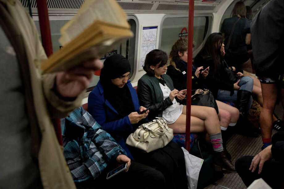 "People take part in the ""No Trousers Tube Ride"" event next to other passengers on an underground train passing through central London, Sunday, Jan. 12, 2014.  The stunt was held to coincide with the ""Global No Pants Subway Ride"", where passengers board subway cars in the middle of winter without wearing trousers and act normally. Photo: Matt Dunham, AP  / AP"