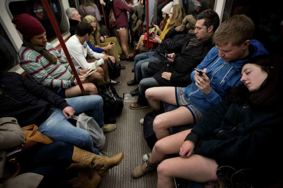 "People take part in the ""No Trousers Tube Ride"" event next to other passengers on an underground train passing through central London, Sunday, Jan. 12, 2014.  The stunt was held to coincide with the ""Global No Pants Subway Ride"", where random passengers board subway cars in the middle of winter without wearing trousers and act normally. Photo: Matt Dunham, AP / AP"