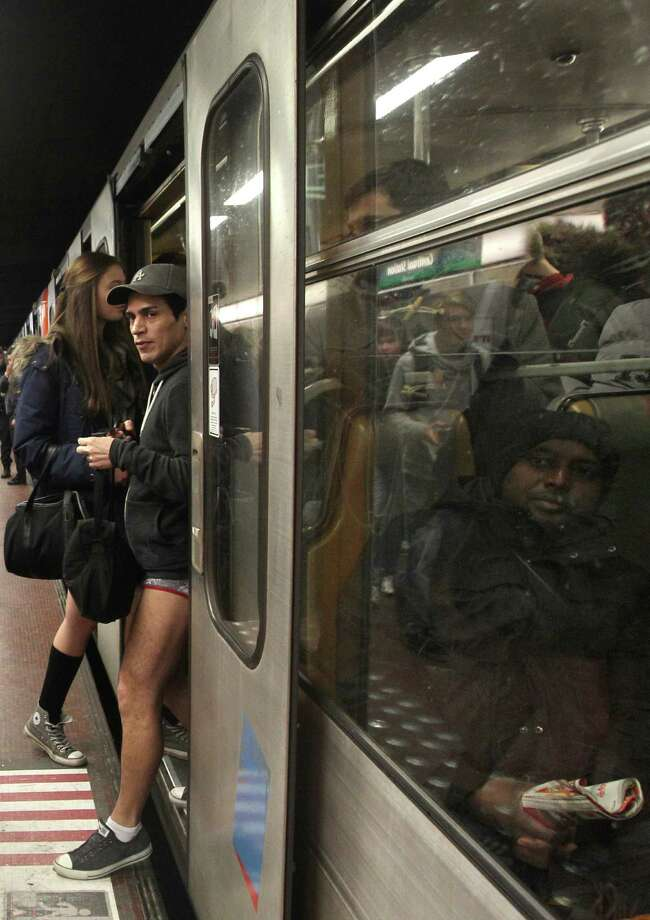 A man with no pants steps out of the metro, as he takes part in the 'No Pants Metro Ride' in Brussels, Sunday, Jan. 12, 2014. The idea started years ago as a small prank in New York and has grown into an international celebration of silliness, with dozens of cities around the world participating each year. Photo: Yves Logghe, AP  / AP