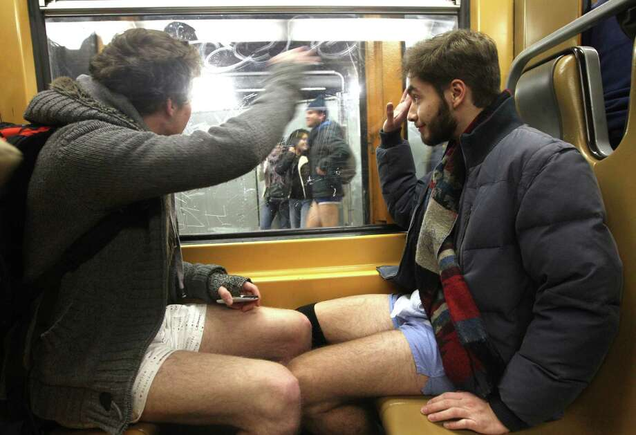 Participants take part in the 'No Pants Metro Ride' in Brussels, Sunday, Jan. 12, 2014. The idea started years ago as a small prank in New York and has grown into an international celebration of silliness, with dozens of cities around the world participating each year. Photo: Yves Logghe, AP  / AP