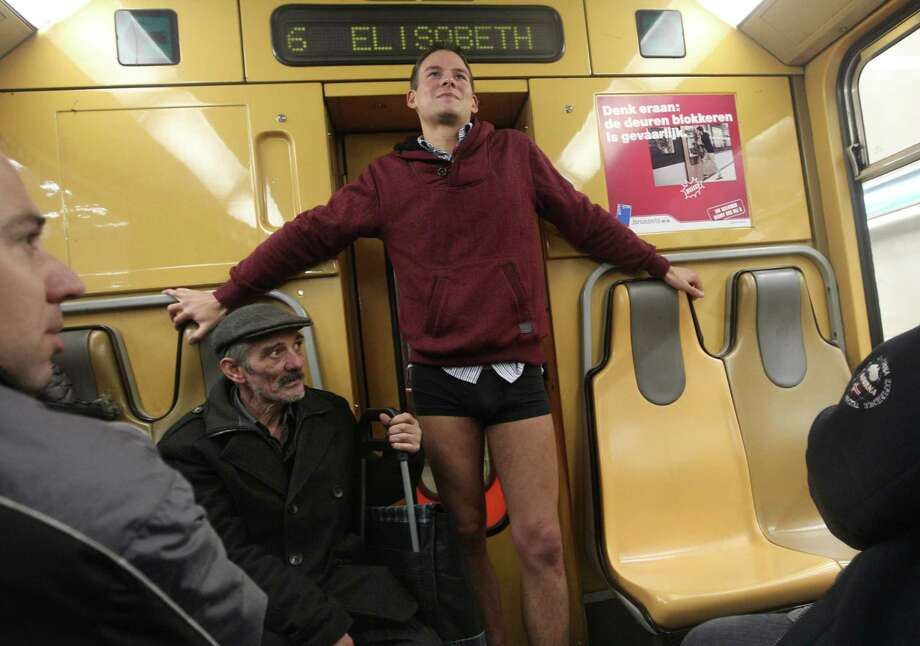 A man with no pants takes part in the 'No Pants Metro Ride' in Brussels, Sunday, Jan. 12, 2014. The idea started years ago as a small prank in New York and has grown into an international celebration of silliness, with dozens of cities around the world participating each year. Photo: Yves Logghe, AP  / AP