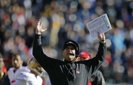 San Francisco's head coach Jim Harbaugh, reacts after further review of a catch by the 49ers Vernon Davis, which was ruled a touchdown, during the second quarter as the San Francisco 49ers take on the Carolina Panthers in the NFC divisional playoffs in Charlotte, North Carolina on Sunday Jan. 12, 2014, at Bank of America stadium. Photo: Michael Macor, The Chronicle