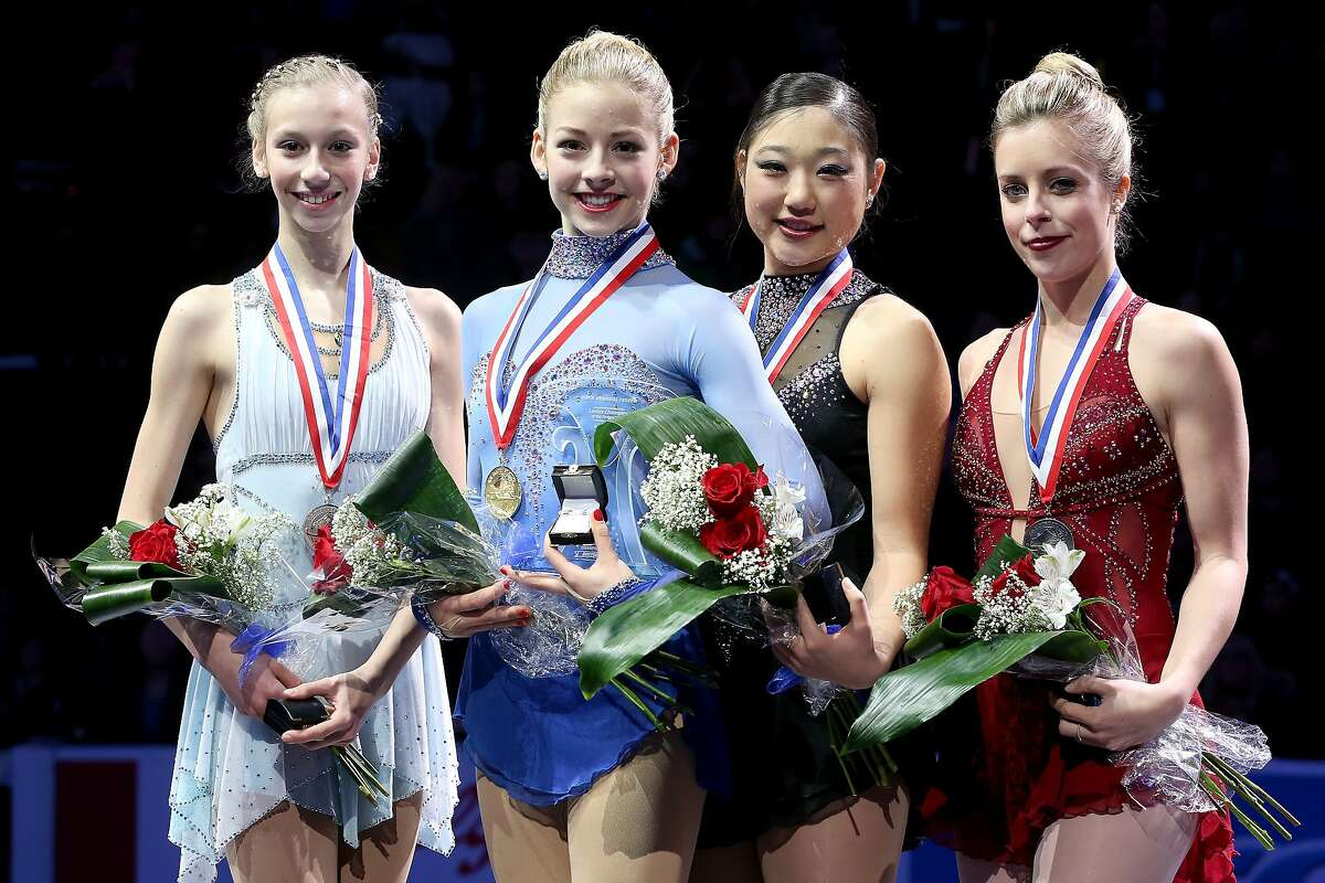 BOSTON, MA - JANUARY 11: Polina Edmunds, Gracie Gold, Marai Nagasu and Ashley Wagner pose on the medals podium after the ladies competition at the Prudential U.S. Figure Skating Championships at TD Garden on January 11, 2014 in Boston, Massachusetts. (Photo by Matthew Stockman/Getty Images)