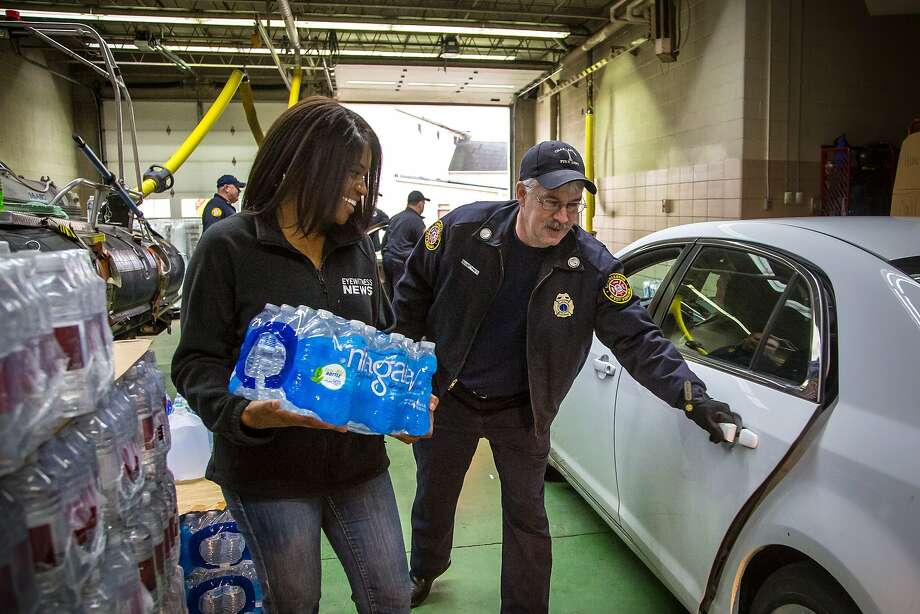 Residents in Charleston, W. Va., pick up bottled water after a chemical spill tainted the local water supply. Photo: Michael Switzer, Associated Press
