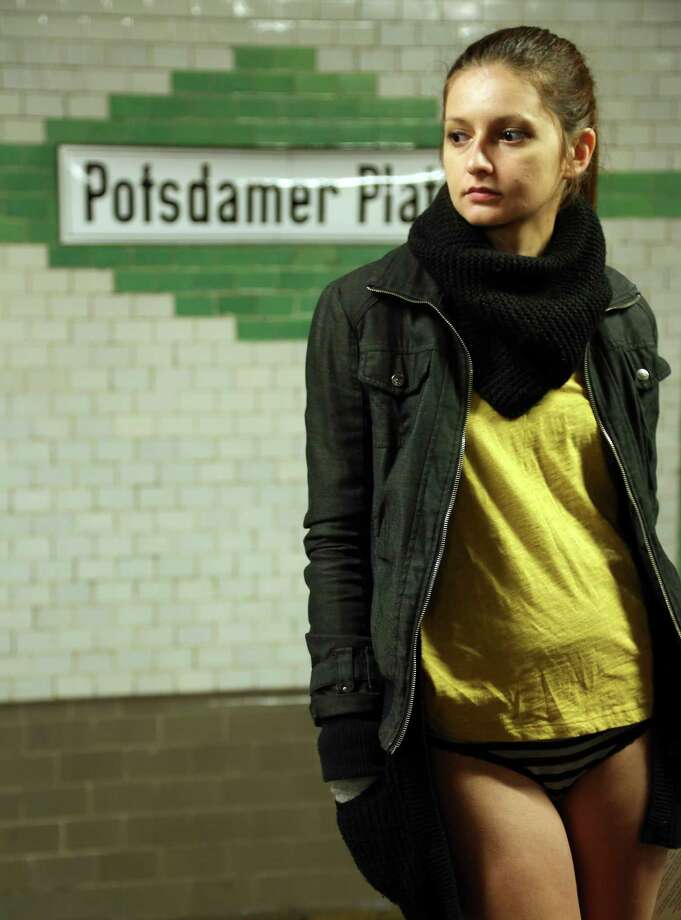 A participant of the No Pants Subway Ride waits for a train on January 12, 2014 in Berlin, Germany. The annual event, in which participants board a subway car in January while not wearing any pants while behaving as though they do not know each other, began as a joke by the public prank group Improv Everywhere in New York City and has since spread around the world, with enthusiasts in around 60 cities and 29 countries across the globe, according to the organization's site. Photo: Adam Berry, Getty Images / 2014 Getty Images