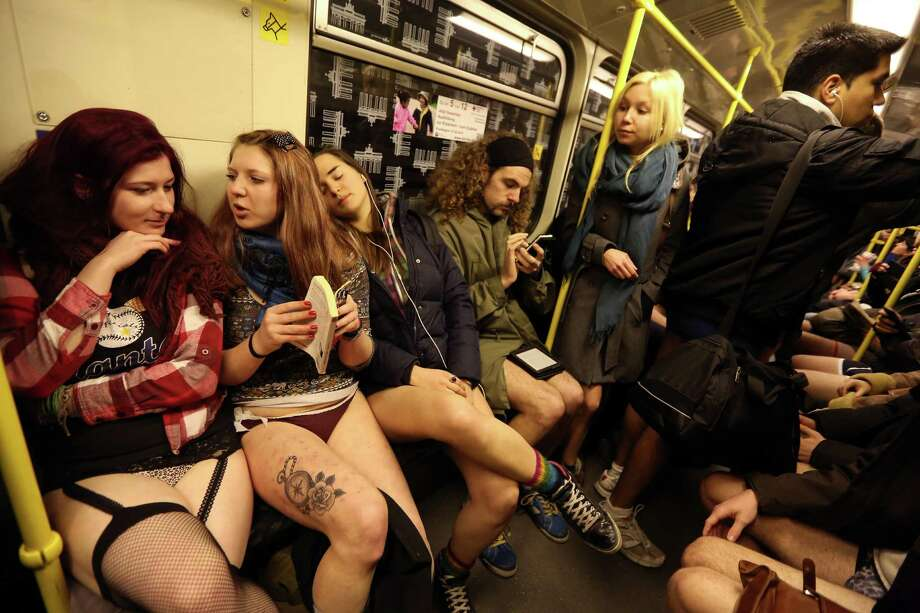 Participants of the No Pants Subway Ride ride a train on January 12, 2014 in Berlin, Germany. The annual event, in which participants board a subway car in January while not wearing any pants while behaving as though they do not know each other, began as a joke by the public prank group Improv Everywhere in New York City and has since spread around the world, with enthusiasts in around 60 cities and 29 countries across the globe, according to the organization's site. Photo: Adam Berry, Getty Images / 2014 Getty Images