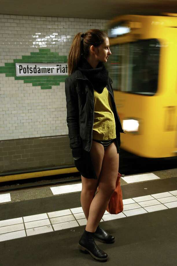 A participant of the No Pants Subway Ride prepares to board an approaching train on January 12, 2014 in Berlin, Germany. The annual event, in which participants board a subway car in January while not wearing any pants while behaving as though they do not know each other, began as a joke by the public prank group Improv Everywhere in New York City and has since spread around the world, with enthusiasts in around 60 cities and 29 countries across the globe, according to the organization's site. Photo: Adam Berry, Getty Images / 2014 Getty Images