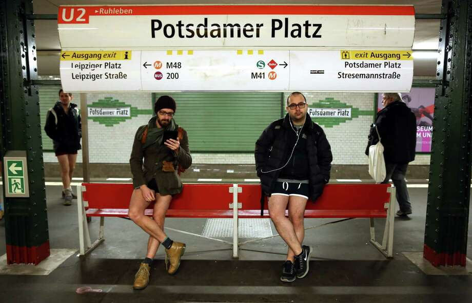 Participants of the No Pants Subway Ride wait for a train on January 12, 2014 in Berlin, Germany. The annual event, in which participants board a subway car in January while not wearing any pants while behaving as though they do not know each other, began as a joke by the public prank group Improv Everywhere in New York City and has since spread around the world, with enthusiasts in around 60 cities and 29 countries across the globe, according to the organization's site. Photo: Adam Berry, Getty Images / 2014 Getty Images