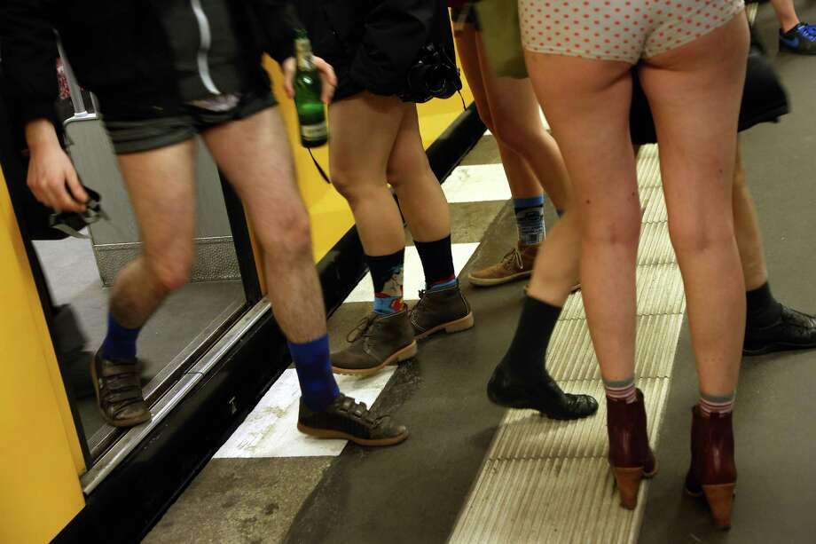 Participants of the No Pants Subway Ride exit and board a train on January 12, 2014 in Berlin, Germany. The annual event, in which participants board a subway car in January while not wearing any pants while behaving as though they do not know each other, began as a joke by the public prank group Improv Everywhere in New York City and has since spread around the world, with enthusiasts in around 60 cities and 29 countries across the globe, according to the organization's site. Photo: Adam Berry, Getty Images / 2014 Getty Images