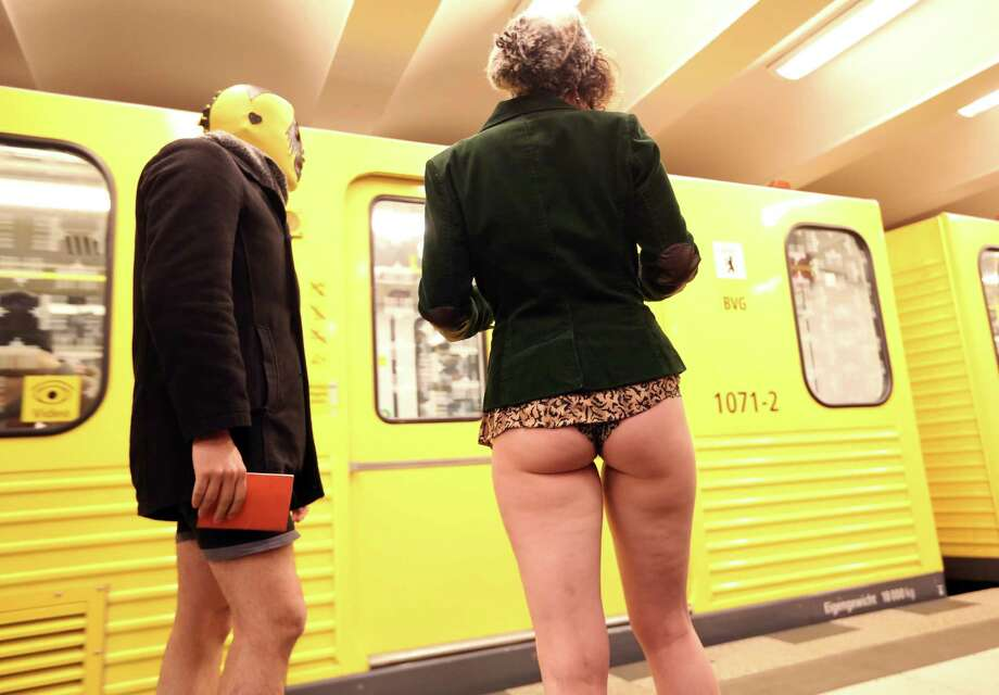 Participants of the No Pants Subway Ride prepare to board a train on January 12, 2014 in Berlin, Germany. The annual event, in which participants board a subway car in January while not wearing any pants while behaving as though they do not know each other, began as a joke by the public prank group Improv Everywhere in New York City and has since spread around the world, with enthusiasts in around 60 cities and 29 countries across the globe, according to the organization's site. Photo: Adam Berry, Getty Images / 2014 Getty Images