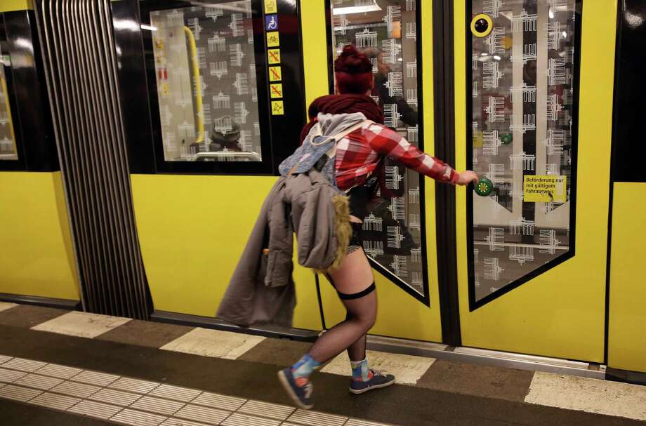 BERLIN, GERMANY - JANUARY 12:  A participant of the No Pants Subway Ride rushes to catch a train on January 12, 2014 in Berlin, Germany. The annual event, in which participants board a subway car in January while not wearing any pants while behaving as though they do not know each other, began as a joke by the public prank group Improv Everywhere in New York City and has since spread around the world, with enthusiasts in around 60 cities and 29 countries across the globe, according to the organization's site. Photo: Adam Berry, Getty Images / 2014 Getty Images