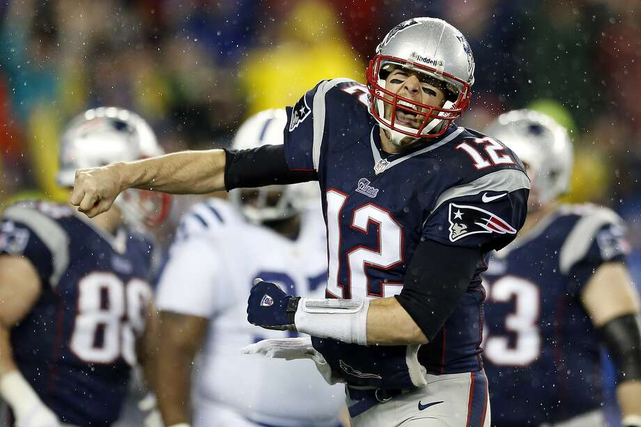 New England quarterback Tom Brady celebrates after one of teammate LeGarrette Blount's four touchdowns. Photo: Michael Dwyer, Associated Press