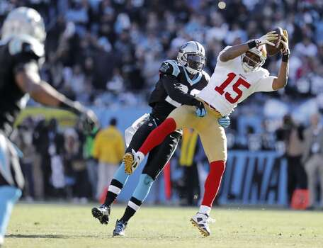 49ers Michael Crabtree, (15) pulls down a first down catch while being covered by the Panthers' Melvin White, (23) during the second quarter as the San Francisco 49ers take on the Carolina Panthers in the NFC divisional playoffs in Charlotte, North Carolina on Sunday Jan. 12, 2014, at Bank of America stadium. Photo: Michael Macor, The Chronicle