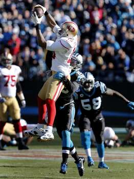 Michael Crabtree (15) had a big catch late in the second quarter Sunday January 12, 2014. The San Francisco 49ers take on the Carolina Panthers in a divisional playoff game at Bank of America stadium in Charlotte, North Carolina. Photo: Brant Ward, The Chronicle
