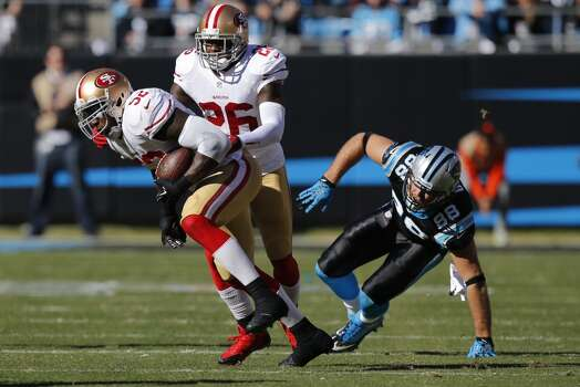49ers' Patrick Willis, (52) incepts a pass intended for Greg OLsen, (88) during the first quarter as the San Francisco 49ers take on the Carolina Panthers in the NFC divisional playoffs in Charlotte, North Carolina on Sunday Jan. 12, 2014, at Bank of America stadium. Photo: Michael Macor, The Chronicle