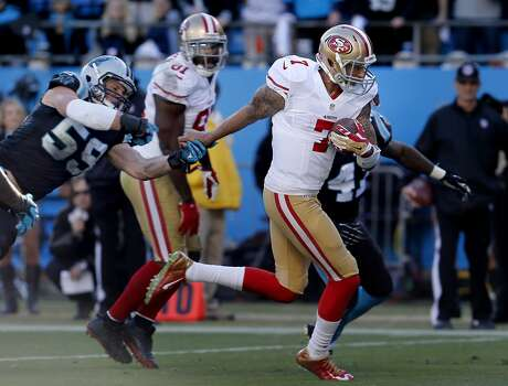 Colin Kaepernick (7) ran over the goal line for a touchdown early in the third quarter Sunday January 12, 2014. Luke Kuechly (59) tried to defend.  The San Francisco 49ers beat the Carolina Panthers 23-10 in Charlotte, North Carolina to advance to the NFC title game against Seattle. Photo: Brant Ward, The Chronicle