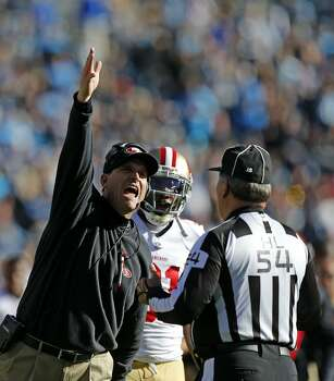 49ers' head coach Jim Harbaugh argues the Vernon Davis catch near the end of the second quarter, as the San Francisco 49ers went on to beat the Carolina Panthers 23-10 in the NFC divisional playoffs in Charlotte, North Carolina on Sunday Jan. 12, 2014, at Bank of America stadium. Photo: Michael Macor, The Chronicle
