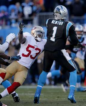 NaVaorro Bowman (53) forced a sack of Panther quarterback Cam Newton in the second half Sunday January 12, 2014. The San Francisco 49ers beat the Carolina Panthers 23-10 in Charlotte, North Carolina to advance to the NFC title game against Seattle. Photo: Brant Ward, The Chronicle
