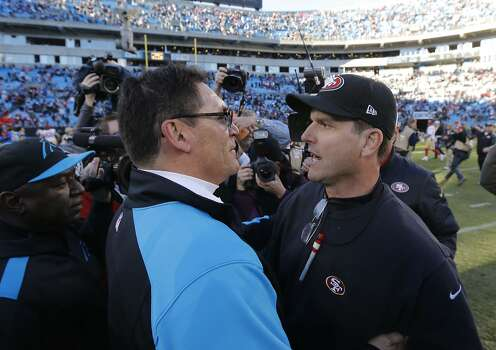Panthers' head coach Ron Rivera, (left) and 49ers' head coach Jim Harbaugh meet after the San Francisco 49ers beat the Carolina Panthers 23-10 in the NFC divisional playoffs in Charlotte, North Carolina on Sunday Jan. 12, 2014, at Bank of America stadium. Photo: Michael Macor, The Chronicle