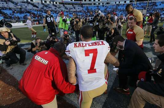 49er quarterback Colin Kaepernick, (7) joins in a prayer cicle at the end of the game, as the San Francisco 49ers beat the Carolina Panthers 23-10 in the NFC divisional playoffs in Charlotte, North Carolina on Sunday Jan. 12, 2014, at Bank of America stadium. Photo: Michael Macor, The Chronicle