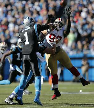 49ers' Aldon Smith, (99) keeps pressure on Panther quarterback Cam Newton, (1) during the first half, as the San Francisco 49ers went on to beat the Carolina Panthers 23-10 in the NFC divisional playoffs in Charlotte, North Carolina on Sunday Jan. 12, 2014, at Bank of America stadium. Photo: Michael Macor, The Chronicle