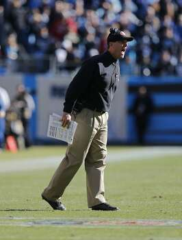 49ers' head coach Jim Harbaugh yells to officials in the first half,  as the San Francisco 49ers went on to beat the Carolina Panthers 23-10 in the NFC divisional playoffs in Charlotte, North Carolina on Sunday Jan. 12, 2014, at Bank of America stadium. Photo: Michael Macor, The Chronicle