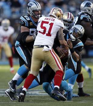 49ers' Dan Skuta, (51) sacks Panthers' quarterback Cam Newton, (1) in the fourth quarter,  as the San Francisco 49ers went on to beat the Carolina Panthers 23-10 in the NFC divisional playoffs in Charlotte, North Carolina on Sunday Jan. 12, 2014, at Bank of America stadium. Photo: Michael Macor, The Chronicle