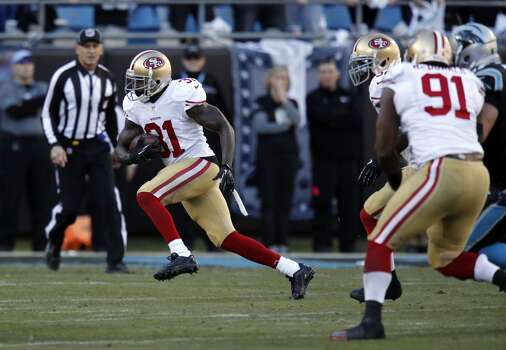 49ers' Donte Whitner, (31) runs with a fourth quarter interception as the San Francisco 49ers went on to beat the Carolina Panthers 23-10 in the NFC divisional playoffs in Charlotte, North Carolina on Sunday Jan. 12, 2014, at Bank of America stadium. Photo: Michael Macor, The Chronicle