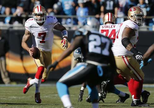 49ers' quarterback Colin Kaepernick, (7) on a first quarter run, as the San Francisco 49ers went on to beat the Carolina Panthers 23-10 in the NFC divisional playoffs in Charlotte, North Carolina on Sunday Jan. 12, 2014, at Bank of America stadium. Photo: Michael Macor, The Chronicle