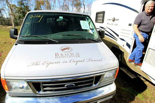 A 2006 Ford E350 van with the Brown Hand Center logo, on display before bidding began at Webster's Auction Palace,Sunday, Jan. 12, 2014, in Houston, during the second of four Sunday auctions of the late Dr. Michael Brown's estate.  The sale of his items are part of a bankruptcy case still in progress in U.S. District Court. Items this time included vehicles, tools, machinery, restaurant equipment and two trailer-mounted generators. Photo: Karen Warren, Houston Chronicle / © 2013 Houston Chronicle