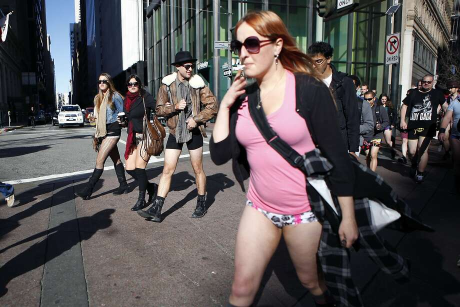 Participants in the annual No-Pants Subway Ride walk down Market St. on their way to Yerba Buena Gardens in San Francisco, CA, Sunday, January 12, 2014. Photo: Michael Short, The Chronicle