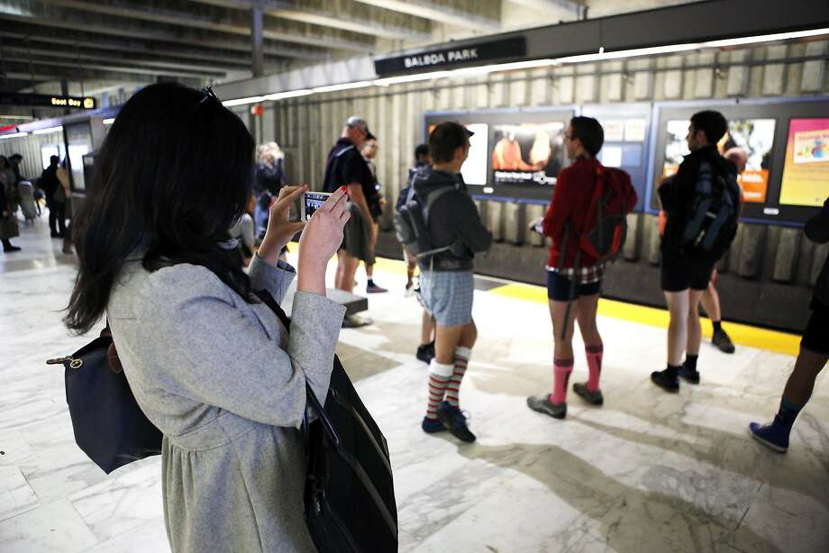 Michelle Wong of San Francisco takes a photo of participants of the annual No-Pants Subway Ride at the Balboa BART station in San Francisco, CA, Sunday, January 12, 2014. Photo: Michael Short, The Chronicle