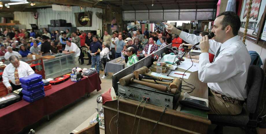 Bidding underway at Webster's Auction Palace,Sunday, Jan. 12, 2014, in Houston.  This is the second of four Sunday auctions of the late Dr. Michael Brown's estate.  The sale of his items are part of a bankruptcy case still in progress in U.S. District Court. Items this time included vehicles, tools, machinery, restaurant equipment and two trailer-mounted generators. Photo: Karen Warren, Houston Chronicle / © 2013 Houston Chronicle