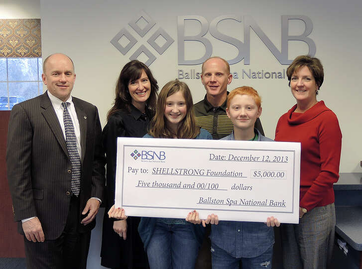 BSNB bank presents a $5,000 donation to the Shellstrong Foundation to sponsor the Feb. 1 Spirits of
