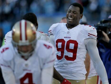 Aldon Smith (99) enjoys a light moment on the bench as the game winds down Sunday January 12, 2014. The San Francisco 49ers beat the Carolina Panthers 23-10 in Charlotte, North Carolina to advance to the NFC title game against Seattle. Photo: Brant Ward, The Chronicle