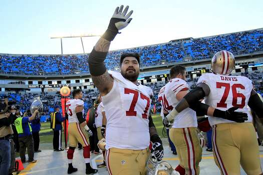 Mike Iupati (77) waved to fans at Bank of America stadium Sunday January 12, 2014. The San Francisco 49ers beat the Carolina Panthers 23-10 in Charlotte, North Carolina to advance to the NFC title game against Seattle. Photo: Brant Ward, The Chronicle