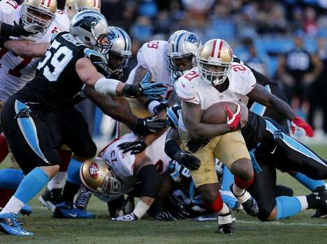 Frank Gore (21) escaped with a big gain and a first down in the second half Sunday January 14, 2014. The San Francisco 49ers beat the Carolina Panthers 23-10 in Charlotte, North Carolina to advance to the NFC title game against Seattle. Photo: Brant Ward, The Chronicle