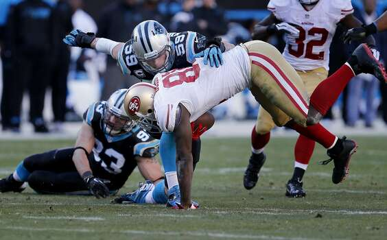 Anquan Boldin (81) is upended by Luke Kuechly (59) in the second half Sunday January 12, 2014. The San Francisco 49ers beat the Carolina Panthers 23-10 in Charlotte, North Carolina to advance to the NFC title game against Seattle. Photo: Brant Ward, The Chronicle
