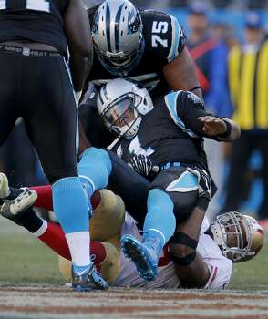 Ahmad Brooks (55) sacks Cam Newton of the Panthers in the second half as Greg Hardy (75) tries to defend Sunday January 12, 2014. The San Francisco 49ers beat the Carolina Panthers 23-10 in Charlotte, North Carolina to advance to the NFC title game against Seattle. Photo: Brant Ward, The Chronicle