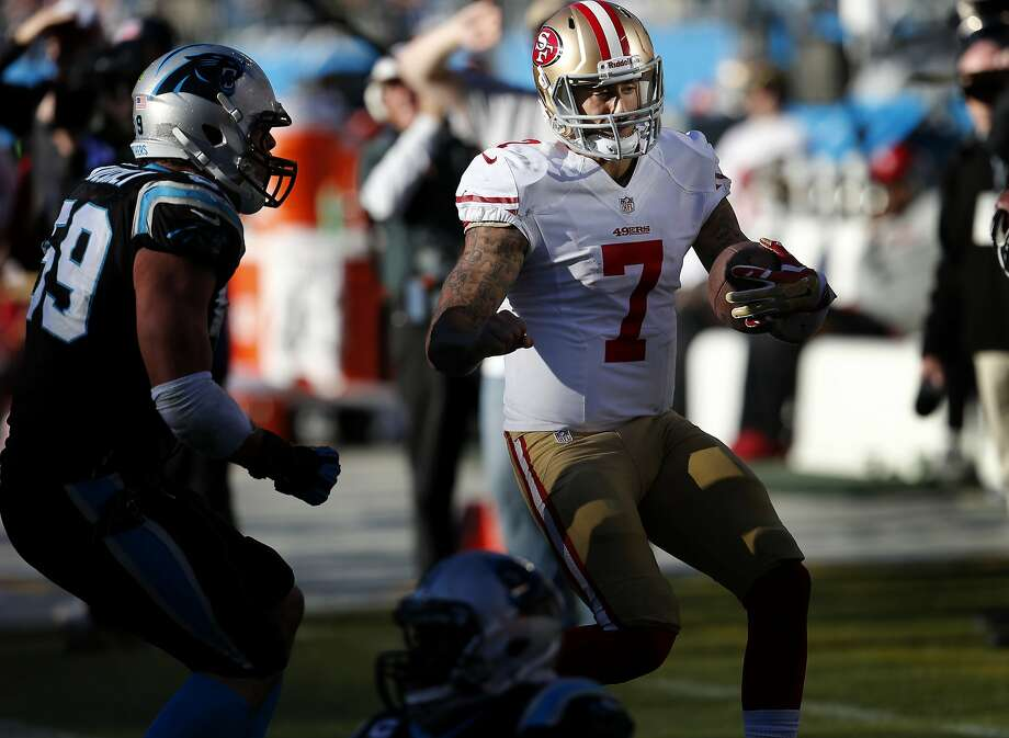 Colin Kaepernick (7) headed toward the sidelines after a run in the second half Sunday January 12, 2014. The San Francisco 49ers beat the Carolina Panthers 23-10 in Charlotte, North Carolina to advance to the NFC title game against Seattle. Photo: Brant Ward, The Chronicle