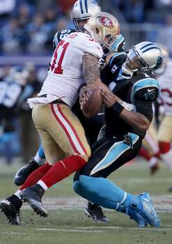 The 49ers Dan Skuta (51) sacks quarterback Cam Newton (1) but is called for excessive force and a 15 yard penalty in the second half Sunday January 12, 2014. The San Francisco 49ers beat the Carolina Panthers 23-10 in Charlotte, North Carolina to advance to the NFC title game against Seattle. Photo: Brant Ward, The Chronicle