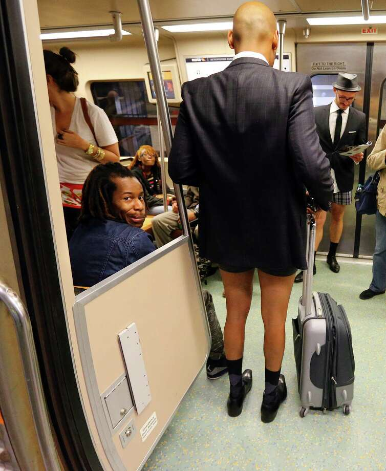 A MARTA rider reacts as Bruce Waine, right,Atlanta, boards his train without his pants on during the No Pants Subway Ride Atlanta annual event on MARTA, Sunday, Jan. 12, 2014, in Atlanta. The staged event is organized by Improv Everywhere. (AP Photo/Atlanta Journal-Constitution, Curtis Compton) MARIETTA DAILY OUT; GWINNETT DAILY POST OUT; LOCAL TV OUT; WXIA-TV OUT; WGCL-TV OUT. Photo: Curtis Compton, AP / Atlanta Journal & Constitution