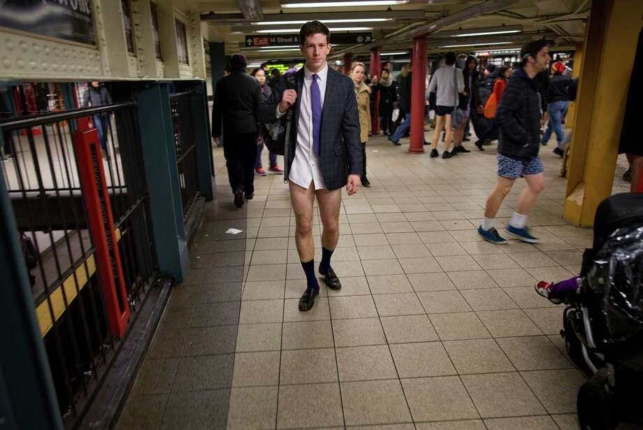 People not wearing pants walk in the 14th Street Union Square subway station as they take part in the annual No Pants Subway Ride, Sunday, Jan. 12, 2014, in New York. The event, organized by the group Improv Everywhere, invites people onto the subways without pants to act out what might be a normal commute. Photo: Craig Ruttle, AP / AP2014