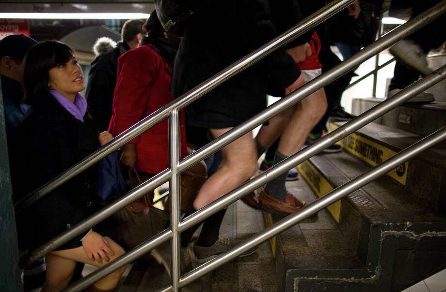 People not wearing pants walk up a stairwell at the 14th Street Union Square subway station as they take part in the annual No Pants Subway Ride, Sunday, Jan. 12, 2014, in New York. The staged event, organized by the group Impro Everywhere, invites people onto the subways without pants to act out what might be a normal commute. Photo: Craig Ruttle, AP / FR61802 AP